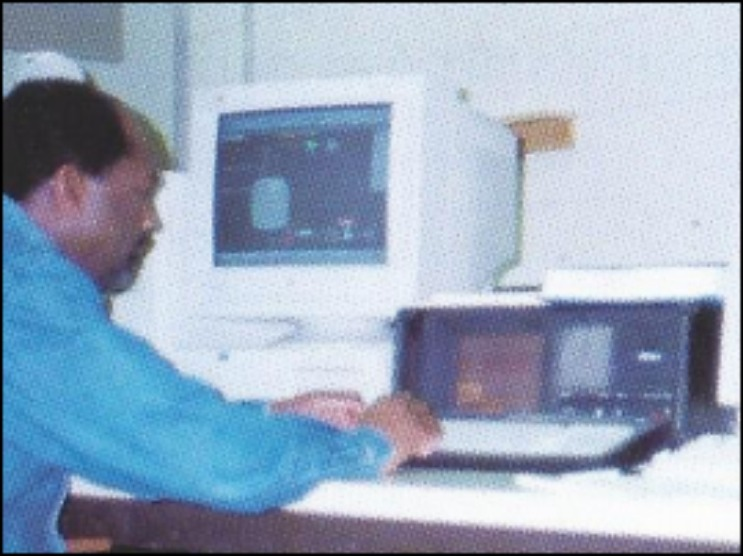 Man on Computer System